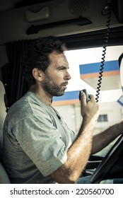 Portrait of a truck driver using CB radio