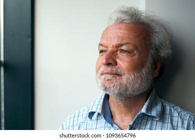 Portrait of Turkish novelist Nedim Gursel in interview in istanbul, Turkey, August 24 2017
