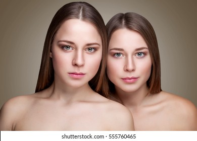 Portrait of twins with perfect skin and long straight hair