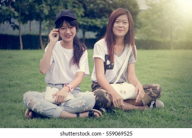 portrait of two asia young girl with bag on park, on outdoor