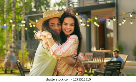 Portrait of Two Beautiful Girls Hugging and Smiling. Best Friends Embrace and Have Fun on a Summer Day.