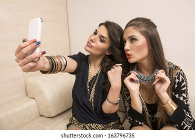 Portrait of two beautiful girls taking pictures of them self's