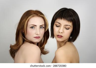 Portrait of two beautiful woman shot in the studio