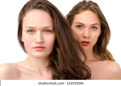 Portrait of two beautiful women, one brunette and one blonde. Focus on the brunette girl in front.