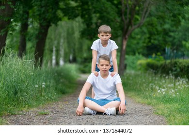 Portrait of two boys (brothers) in nature.