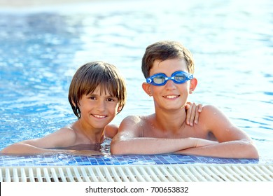 portrait of two boys in a swimming pool