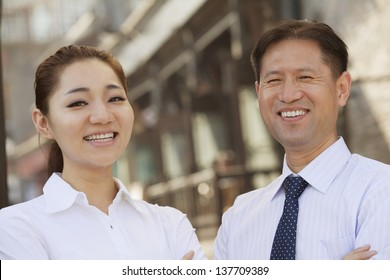 Portrait of two Business People, outdoors, Beijing