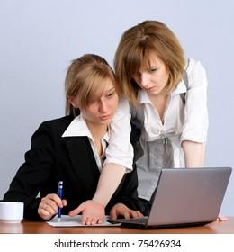 Portrait of two businesswoman viewing laptop