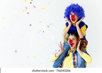 A portrait of two clowns