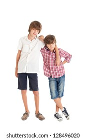 Portrait of two cute boys of European adolescents. Two friends. Embracing friends. Studio shot, isolated on white background.
