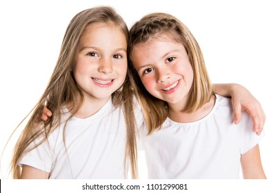 Portrait of two cute friends 7 years old girl Isolated over white background