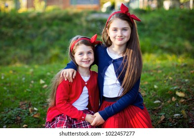 Portrait of two cute sisters embracing