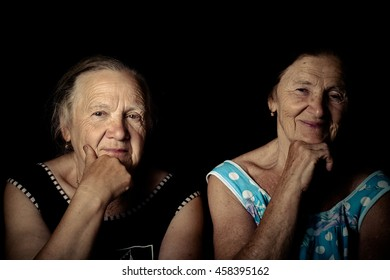 Portrait of two elderly sisters. Dreaminess. Toned.