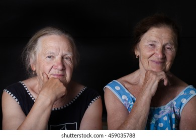 Portrait of two elderly sisters. Dreaminess.