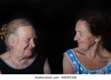 Portrait of two elderly sisters. Smile.