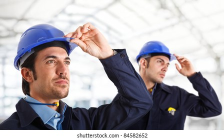 Portrait of two engineers looking at something