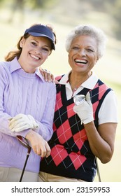 Portrait Of Two Female Golfers