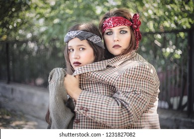 Portrait of two girls outdoors. The concept of difficult teenagers, bad students. Representatives of youth subcultures.