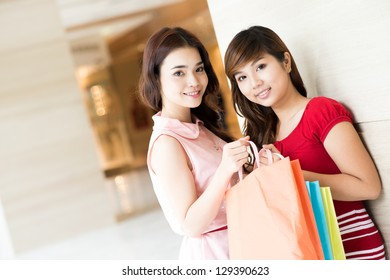 Portrait of two girls shopping in the mall
