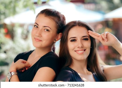 Portrait of Two Happy Beautiful Girls - Smiling cute young women friends posing together