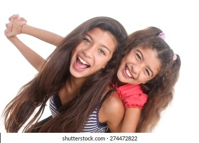 portrait of two happy girls on a white background