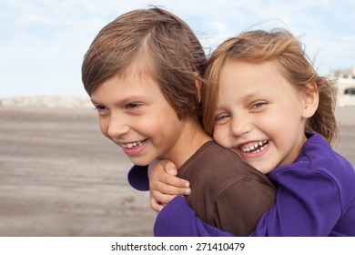portrait of two happy kids outdoors