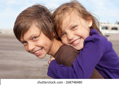 portrait of two happy little friends outdoors