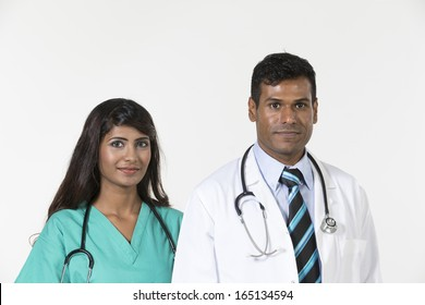 Portrait of two happy Medical Staff.  Isolated on a white background.