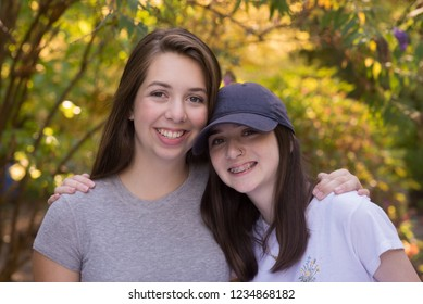 A portrait of two happy teen sisters