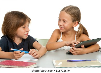 Portrait of two kids discussing homework at desk.Isolated