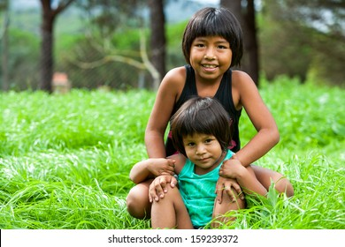 Portrait of two Latin American sisters outdoors.