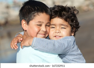 portrait of two little brothers hugging