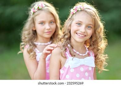 Portrait of two little girls twins