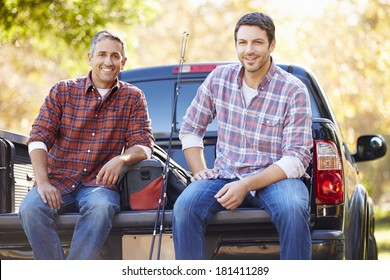 Portrait Of Two Men In Pick Up Truck On Camping Holiday