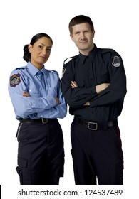 Portrait of two mid adult police officers standing on a white background