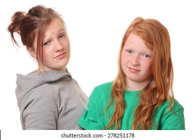 Portrait of two naughty girls on white background