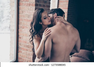 Portrait of two nice adorable lovable sweet gentle delicate tender gorgeous attractive sportive guy people married spouses wavy-haired lady making love in loft industrial interior room wall