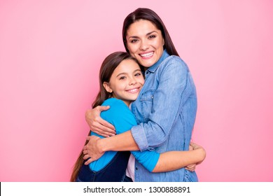 Portrait of two nice cute adorable lovable lovely attractive charming tender cheerful cheery positive girls hugging care trust feelings isolated over pink pastel background