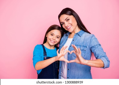 Portrait of two nice cute lovable winsome tender lovely attractive charming cheerful positive straight-haired girls showing heart shape isolated over pink pastel background