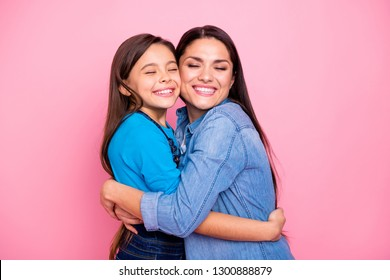 Portrait of two nice cute pretty trendy stylish lovely attractive charming tender cheerful positive girls hugging care trust feelings new family life closed eyes isolated over pink pastel background