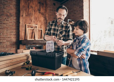 Portrait of two nice person cheerful focused successful woodworkers master handyman learning design production industry at modern loft industrial brick interior