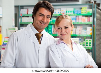 portrait of two pharmacists looking at camera and smiling