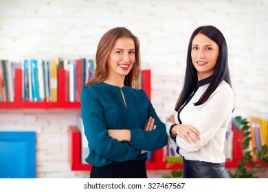 portrait of two pretty business women in office
