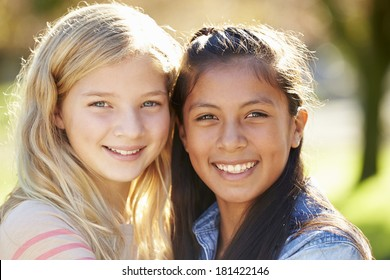 Portrait Of Two Pretty Girls In Countryside
