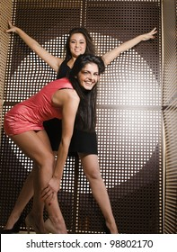 portrait of two pretty girls enjoying party