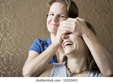 Portrait of Two Pretty Young Women Friends Playing and Laughing