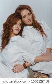 Portrait of two red-haired twin girls with ethnic appearance in an eclectic style.