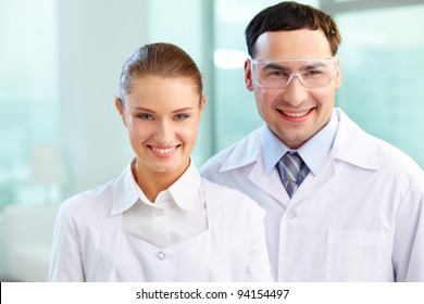Portrait of two scientists en face looking at camera and smiling