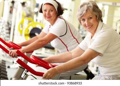 Portrait of two senior women in gym