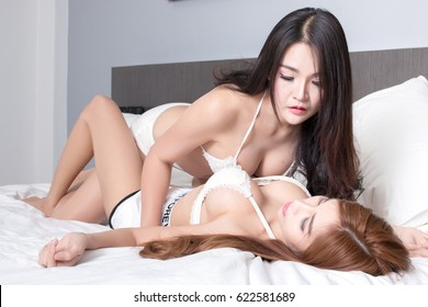 Portrait of Two Sexy Asian woman in bedroom